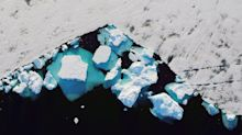 In Greenland, a glacier's collapse shows climate impact