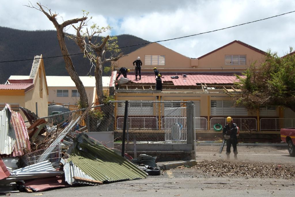 A school is repaired in Marigot on the French Caribbean island of St Martin after Hurricane Irma battered the region earlier this month (AFP Photo/Helene Valenzuela)