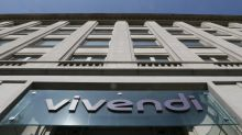 Hedge fund Elliott turns up heat on Vivendi over Telecom Italia