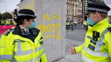 Extinction Rebellion protesters deface Churchill statue despite police presence