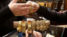 Rolexes and cars; Lebanese spend big to prise savings from the bank