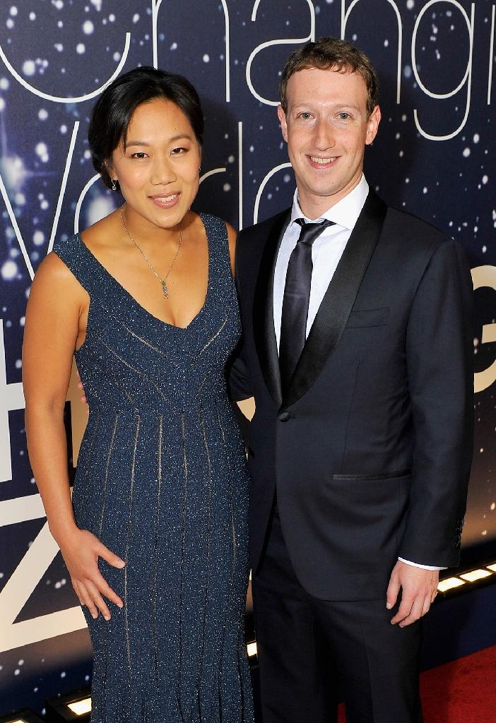 Breakthrough Prize Founders Priscilla Chan and Mark Zuckerberg attend the Breakthrough Prize awards ceremony, at NASA Ames Research Center in Mountain View, California, in November 2014 (AFP Photo/Steve Jennings)