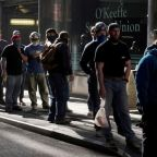 U.S. weekly jobless claims drop below 500,000; layoffs lowest since 2000