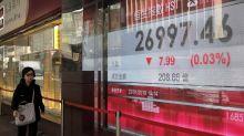 Asian markets struggle; Japan reports weak export data