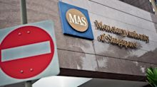 Singapore slaps fines on Credit Suisse and UOB in money laundering probe of Malaysian development fund