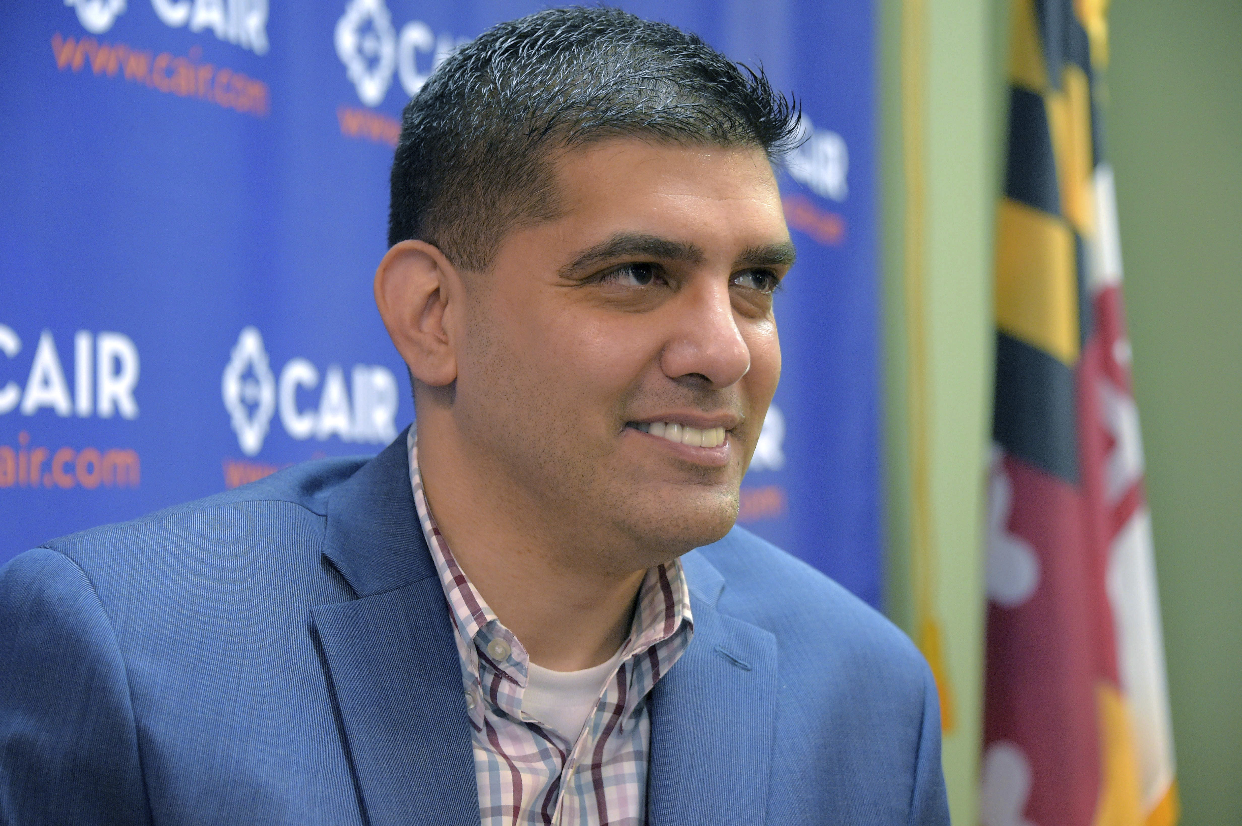 Saqib Ali talks at a press conference Wednesday, Jan. 9, 2019, in Catonsville, Md., announcing a legal challenge to Maryland's anti-BDS Executive Order. Maryland's ban on contracting with businesses that boycott Israel tramples on the First Amendment rights the software engineer who advocates for Palestinians, a Muslim civil rights group claims in a lawsuit filed Wednesday. (Karl Merton Ferron/The Baltimore Sun via AP)