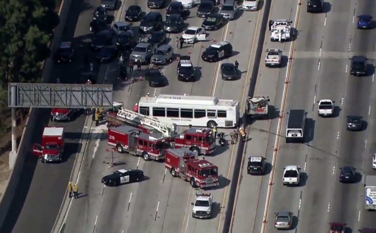 This aerial image made from video provided by KABC-TV shows the wreckage of a bus accident along Interstate 405 in Los Angeles on Sunday, Oct. 14, 2018. Authorities say at least 25 people were injured when the bus crashed into vehicles and through a concrete divider on the highway. (KABC-TV via AP)