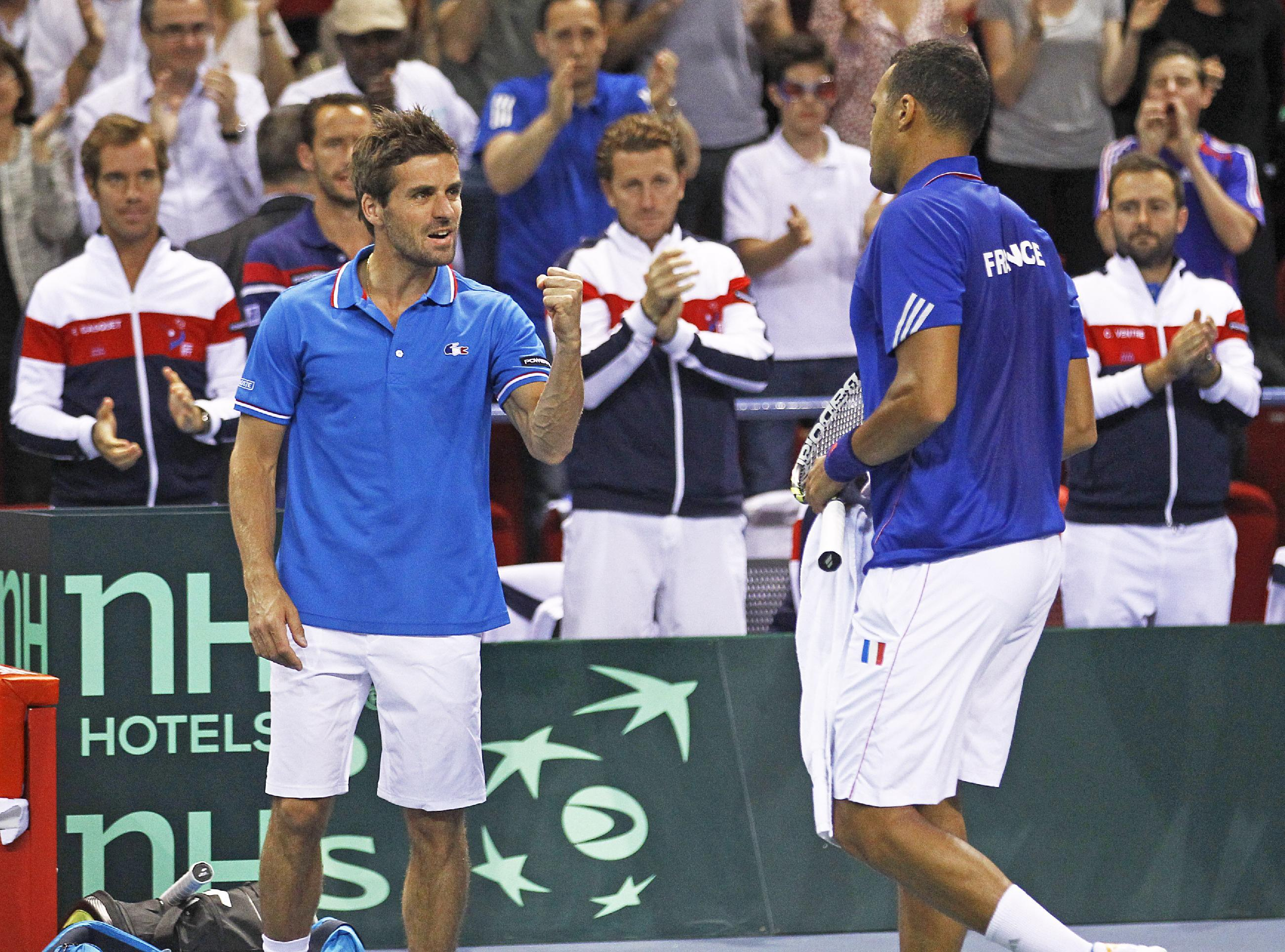 French tennis player Jo-Wilfried Tsonga, right, gets encouragements from French team coach Arnaud Clement, left, during his single match against German player Tobias Kamke, in the quarterfinals of the Davis Cup between France and Germany, in Nancy, eastern France, Sunday April 6, 2014.(AP Photo/Remy de la Mauviniere)