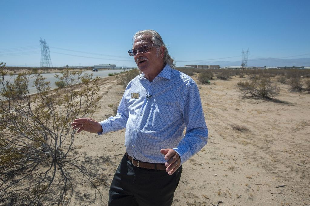 """Adelanto councilman John """"Bug"""" Woodard, Jr. stands on undeveloped desert land in the """"green zone"""", an area designated by the city for industrial scale marijuana cultivation (AFP Photo/David McNew)"""