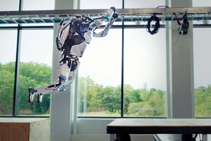 Boston Dynamics Atlas robot performing a parkour leap