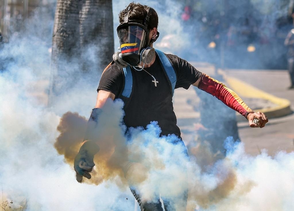 The intensifying economic crisis in Venezuela has sparked waves of ongoing protests (AFP Photo/Juan BARRETO)