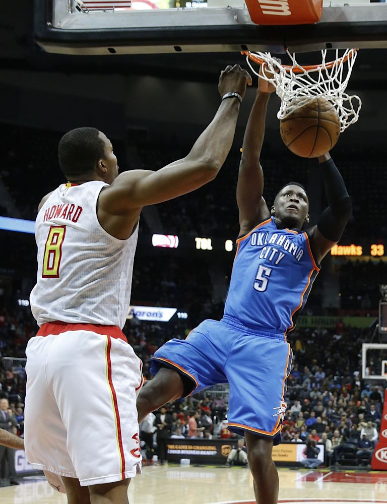 Victor Oladipo enjoys his moment of zen. Dwight Howard? Less so. (AP)