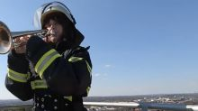 German Firefighter Thanks Dortmund Residents With Gravity-Defying Trumpet Serenade