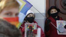 Polish court acquits activists who put LGBT rainbow on icon