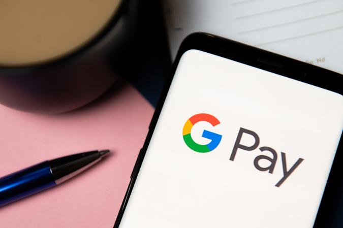 In this photo illustration a Google Pay logo displayed on a...
