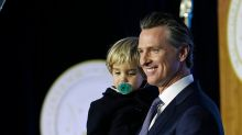 Sleepy toddler upstages governor father during inaugural speech