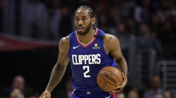 Sources: Kawhi not traveling with Clippers