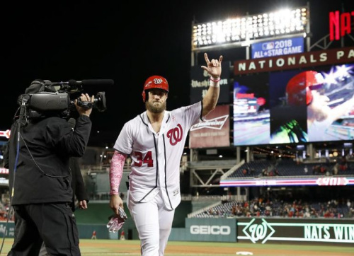 Bryce Harper celebrates his dramatic walk-off home run just hours after signing a record one-year deal with the Nationals. (AP)