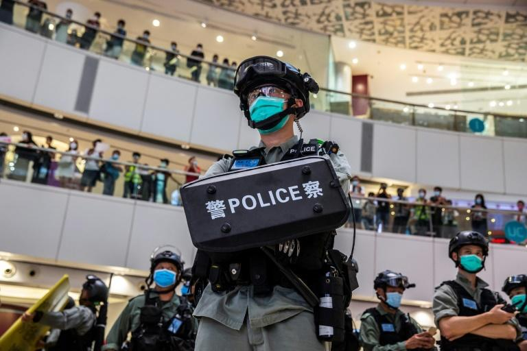 Hong Kong's police have been granted vastly expanded powers to conduct warrantless raids and surveillance -- as well as issue internet takedown notices -- under Beijing's new national security law (AFP Photo/ISAAC LAWRENCE)