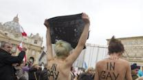 Topless Vatican Protesters: 'In Gay We Trust'