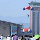 Sky divers drop from the air in North Korea