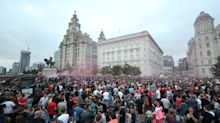 Police seek 12 men and a woman over disorder at Liverpool celebrations