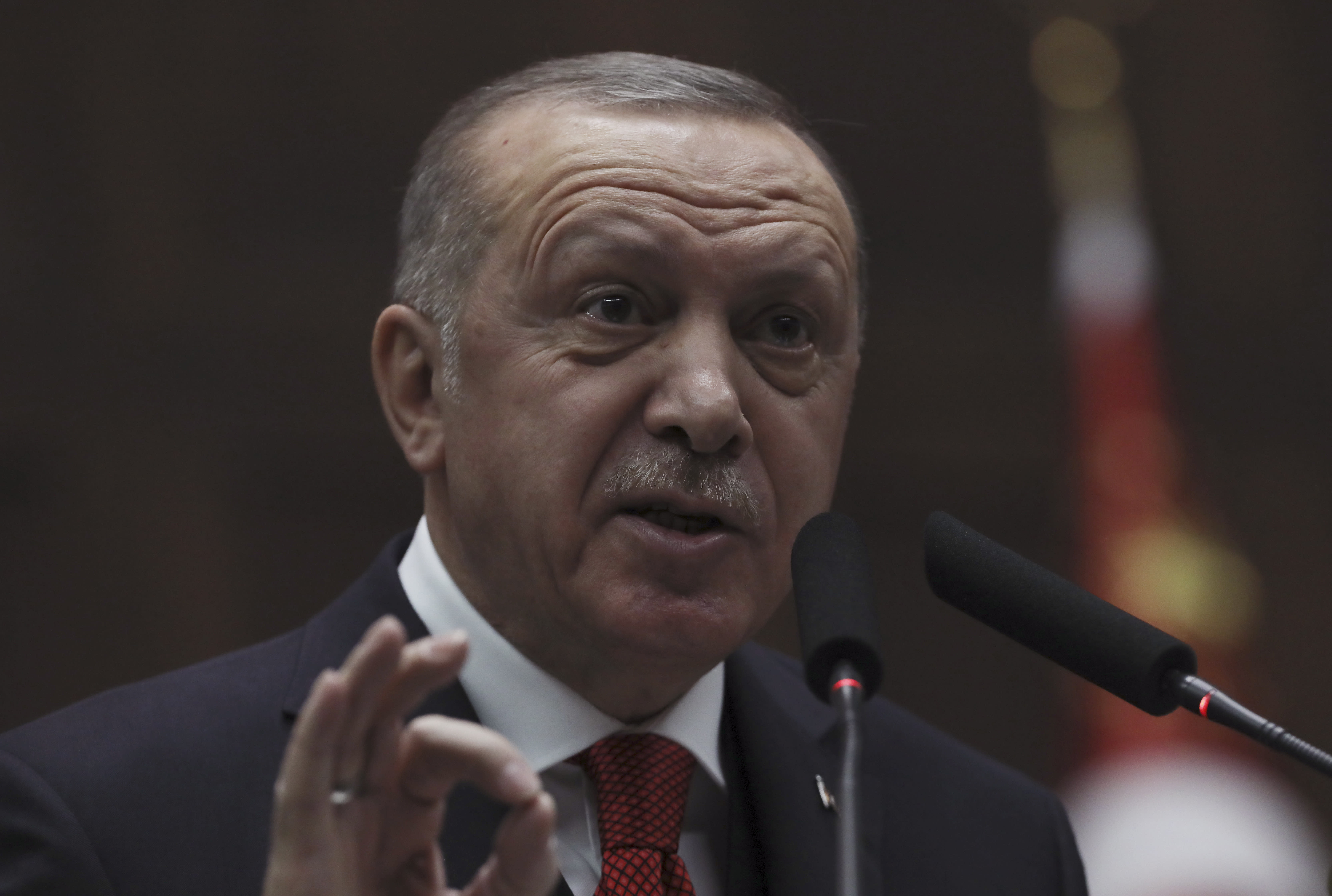 """Turkey's President Recep Tayyip Erdogan addresses his ruling party's legislators, in Ankara, Turkey, Tuesday, Jan. 14, 2020. Erdogan said Turkey would closely follow moves by the two sides in Libya and vowed to teach Khalifa Hifter, the head of the self-styled Libyan National Army, """"the lesson he deserves"""" if attacks on the Tripoli government continued.(AP Photo/Burhan Ozbilici)"""