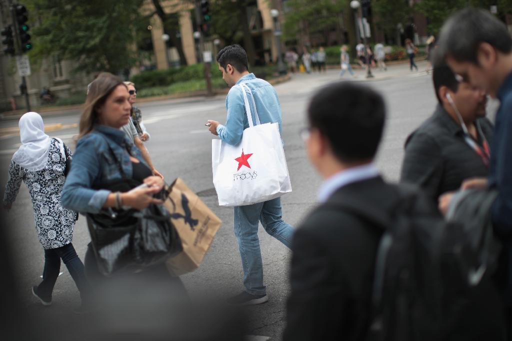 A jump in US consumer spending helped put GDP growth higher than previously reported at 2.9 percent