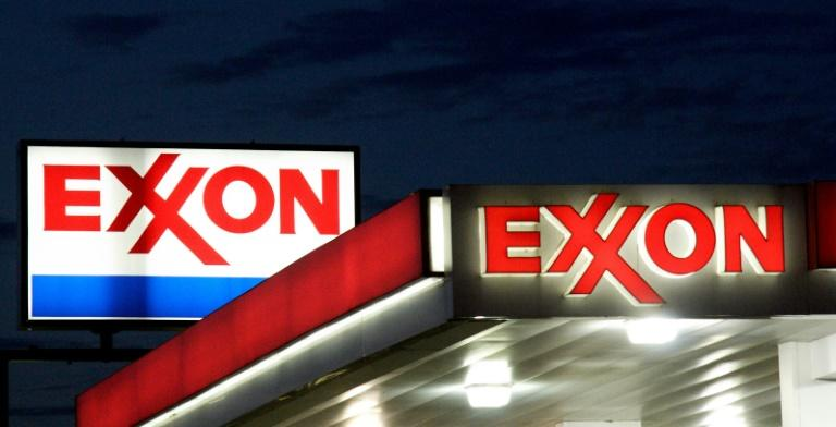 Exxon Mobil profit sinks, Chevron rises as both boost output