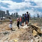 Lebanese flock to blast site five days after massive explosion