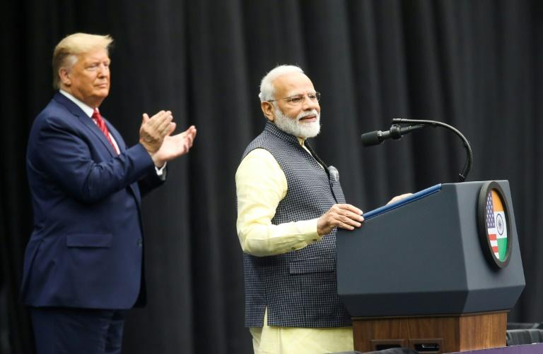 US President Donald Trump claps for Indian Prime Minister Narendra Modi as they address a joint rally in Houston in September 2019