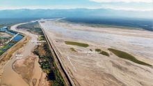 Giant Waste-Spewing Mine Turns Into a Battleground in Indonesia