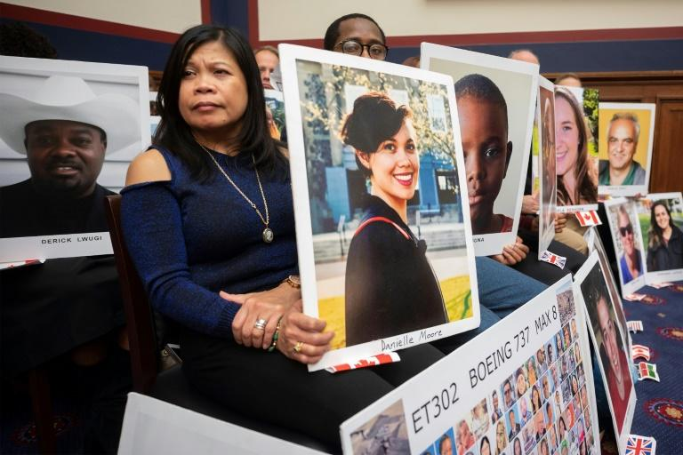 Pictures of the victims of Boeing 737 MAX accidents were on display as FAA Stephen Dickson testified in Congress in December 2019