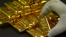 Gold climbs as investors await Fed rate view, dollar fades