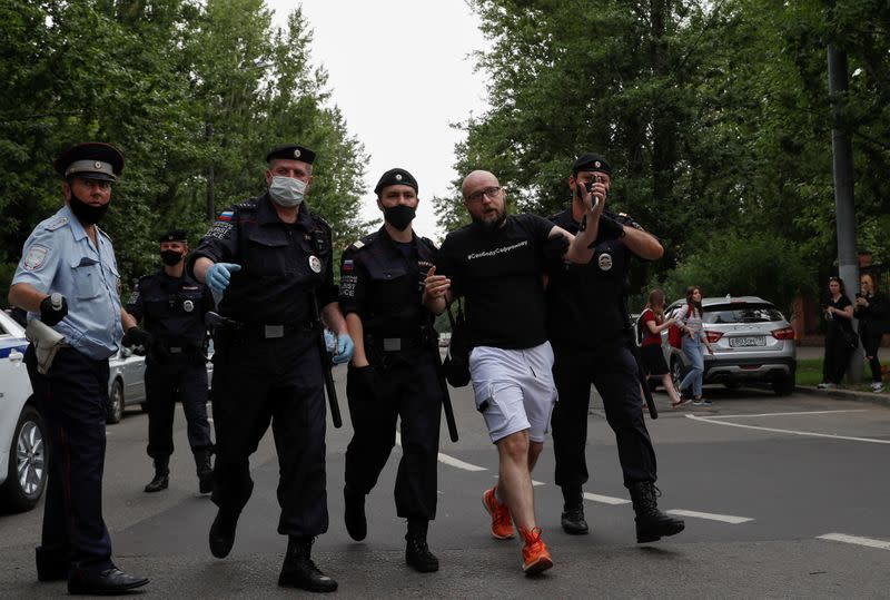 Policemen detain a participant of a picket in support of former journalist Ivan Safronov in Moscow