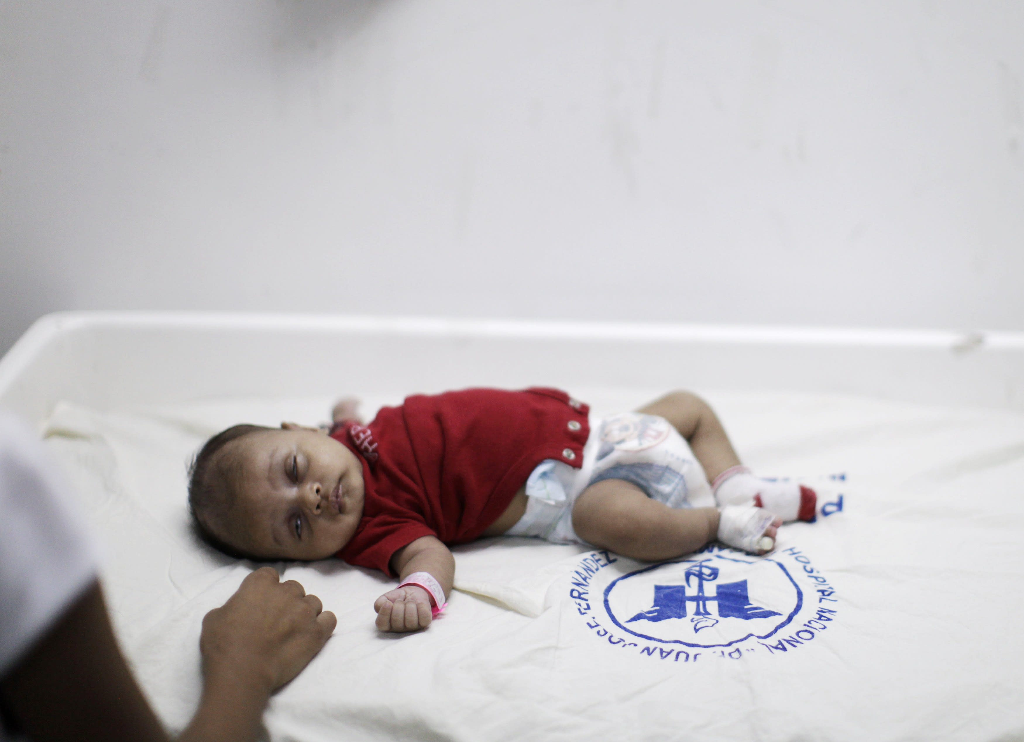 Baby Miguel Angel is being looked after by a nurse as he is showing chikungunya fever symptons at the pediatric ward of the Zacamil Hospital in Mejicanos, on the outskirts of San Salvador