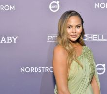 Chrissy Teigen said she's in a 'grief depression hole' after defending Meghan Markle's essay about miscarriage