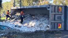 'They go too fast': Truckie slammed online after losing load at roundabout