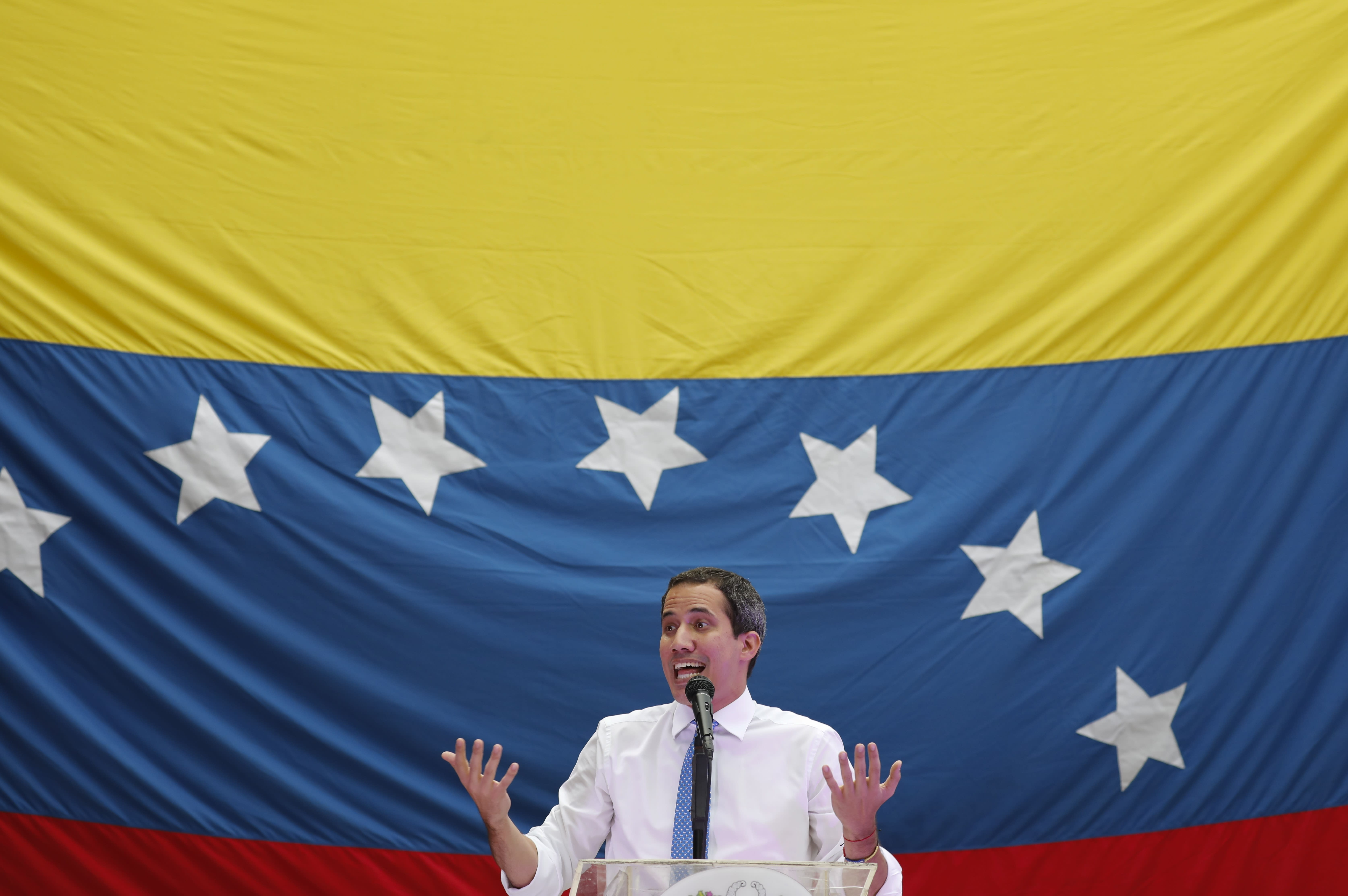 Opposition leader and self-proclaimed interim President Juan Guaido speaks during a citizen assembly at a square in the neighborhood of El Paradiso in Caracas, Venezuela, Monday, Sept. 30, 2019. On Monday, Guaidó came out in defense of the Colombian government claim that Colombian guerrilla troops are operating in Venezuela, and accused Venezuelan President Nicolas Maduro of supporting them. (AP Photo/Ariana Cubillos)