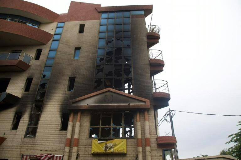 The burnt-out home of the former justice minister after an attack by protesters was one of the few visible signs of the overthrow