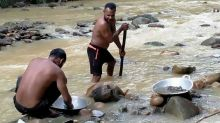 Pandemic panners: Indonesians hunt for gold in desperate times