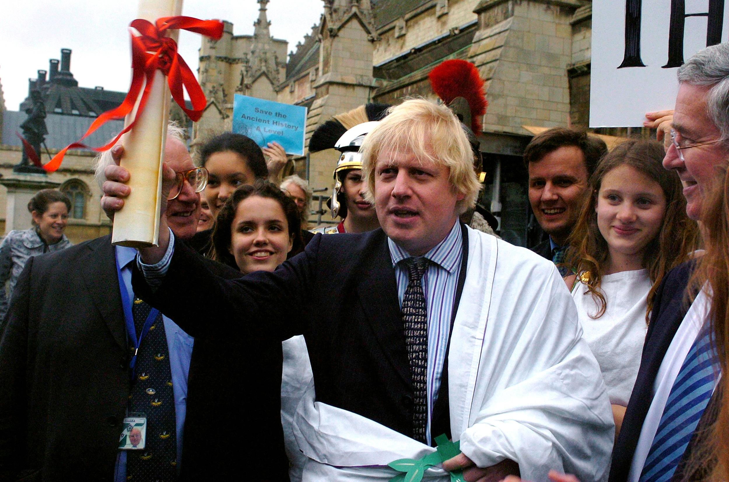 Boris Johnson MP addresses a group of sixth form students from schools across London after being handed a petition against plans to scrap the last remaining ancient history A-level outside the House of Commons, London.