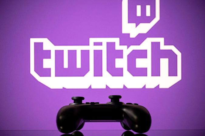 A gamepad is pictured as a screen displays the online Twitch plateform in Toulouse, southwestern France, on June 15, 2021. (Photo by Lionel BONAVENTURE / AFP) (Photo by LIONEL BONAVENTURE/AFP via Getty Images)