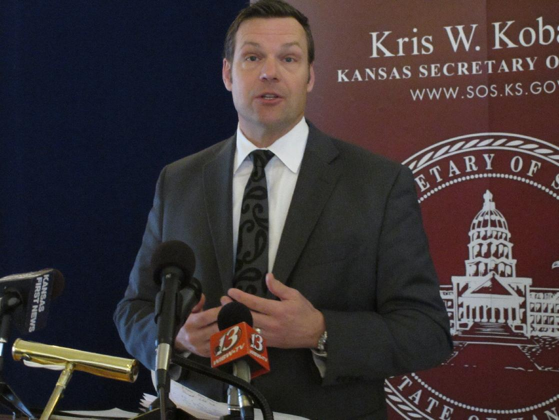 Kansas Secretary of State Kris Kobach discusses a federal judge's ruling ordering the federal government to help Kansas and Arizona enforce their proof-of-citizenship requirements for new voters, Wednesday, March 19, 2014, in Topeka, Kan. Kobach and Arizona Secretary of State Ken Bennett filed a lawsuit over the issue. (AP Photo/John Hanna)
