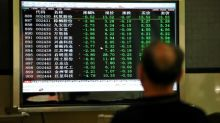 Asian shares turn lower on guarded Fed, yen rises after BOJ