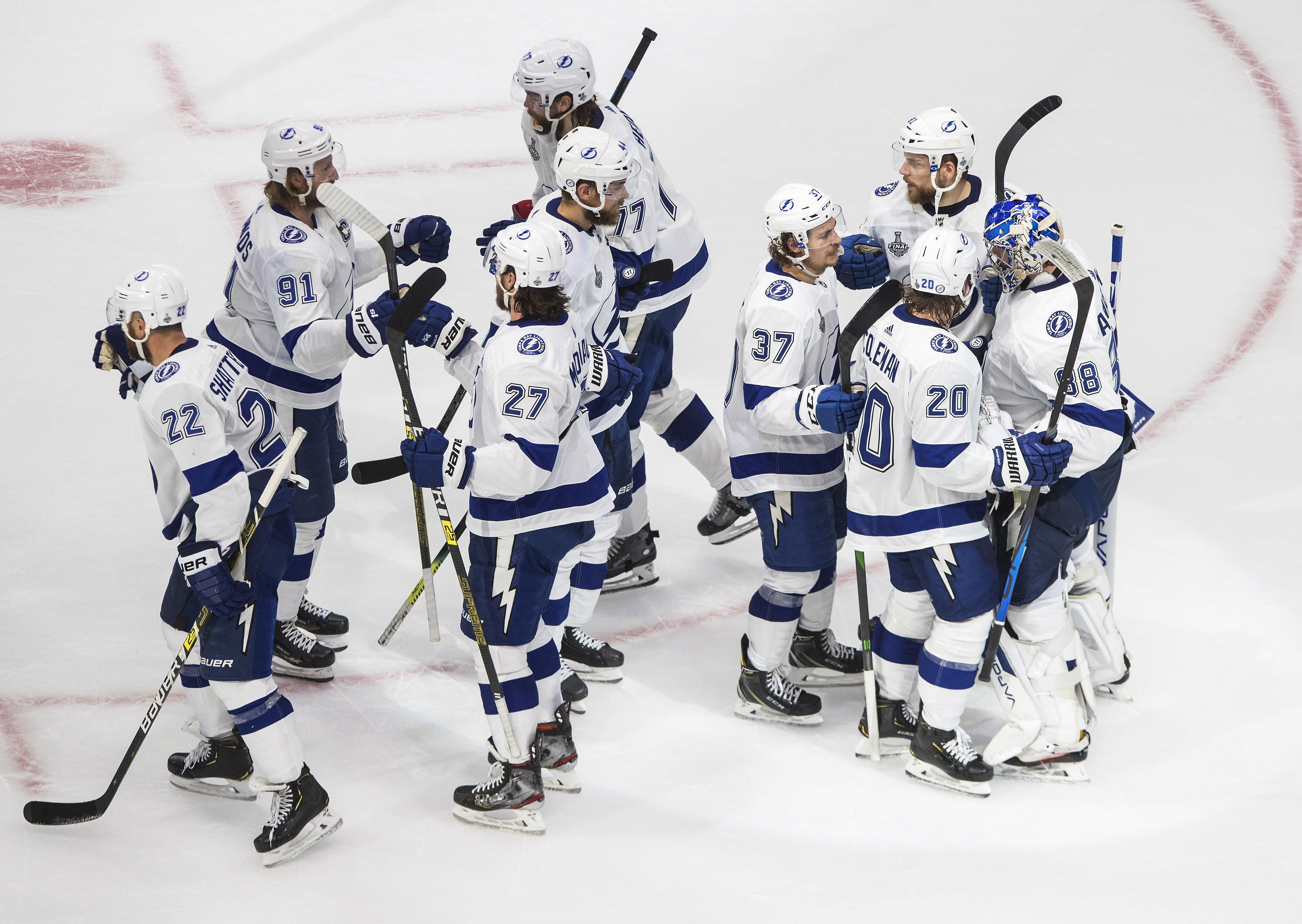Tampa Bay Lightning players celebrate a win over the Dallas Stars in Game 3 of the NHL hockey Stanley Cup Final, Wednesday, Sept. 23, 2020, in Edmonton, Alberta. (Jason Franson/The Canadian Press via AP)