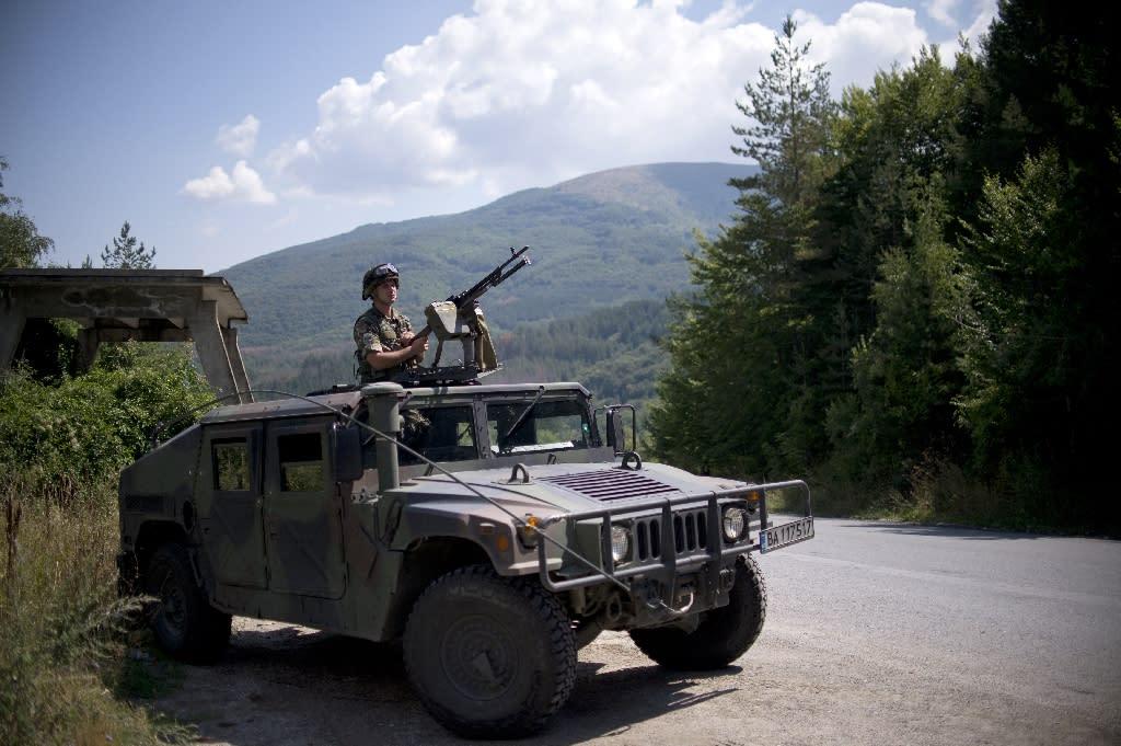 A Bulgarian soldier stands guard on a military vehicle near the border with Macedonia near Gyueshevo on August 26, 2015 (AFP Photo/Nikolay Doychinov)