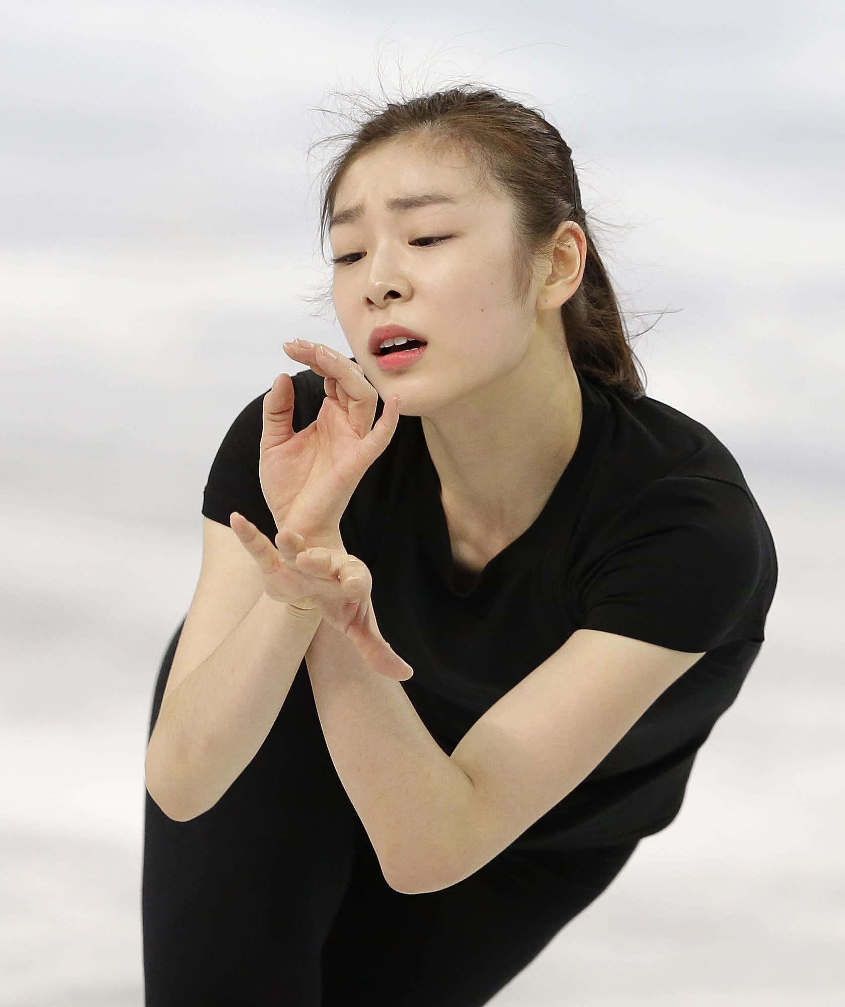 2010 champion Yuna Kim taking Olympics like a job