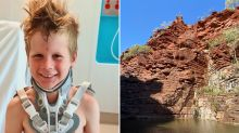 Brave boy survives eight-metre fall from outback cliff