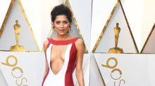 Actress Blanca Blanco wears a red gown to the Oscars that's basically a 'wardrobe malfunction waiting to happen'